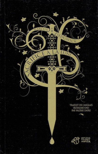 French cover of Midwinterblood with gold design of a dagger with title text around it.