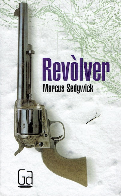 Spanish cover of Revolver showing revolver on snow and a map of the Arctic.