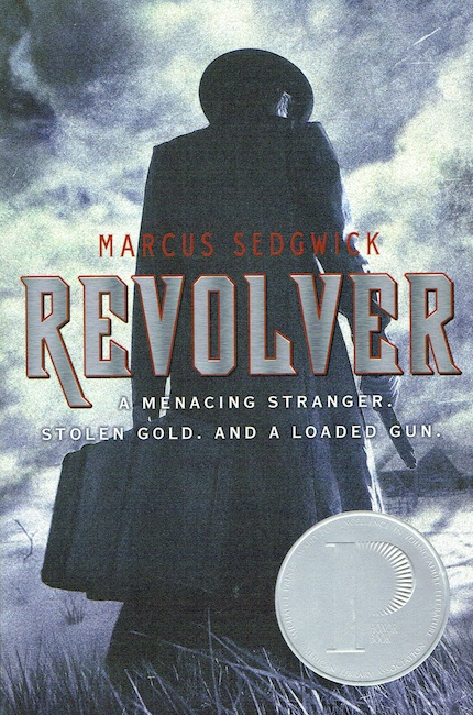 US cover of Revolver with man seen from behind holding a suitcase and a pistol.
