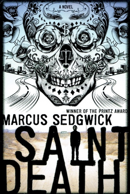 US cover of Saint Death with Mexican skull design hovering over desert.