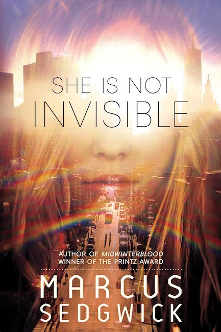 US cover of She Is Not Invisible with part of girl's face overlaid on Manhattan landscape.